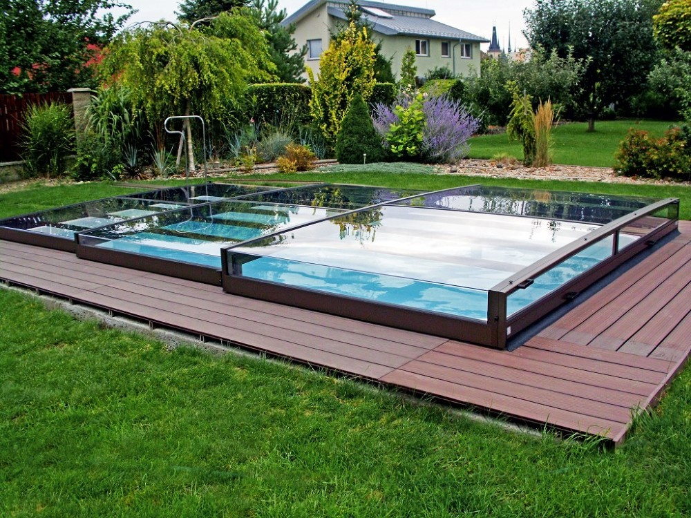 swimming pool enclosure terra fits great into blooming garden
